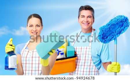 Professional cleaners team. Over blue background. - stock photo