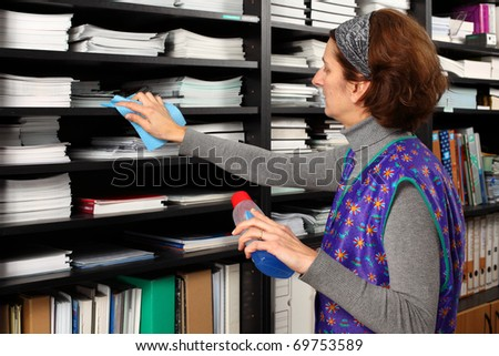 Professional cleaning lady clean office. - stock photo