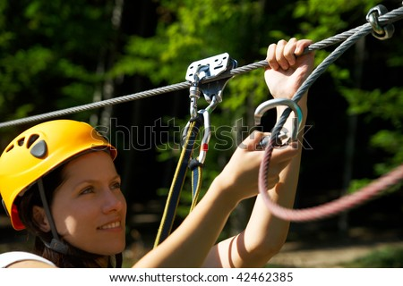 professional climbing gear with helmet pulley and carabiner - stock photo