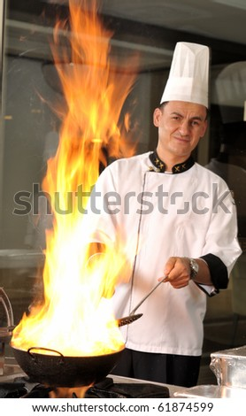 Professional cook preparing food on flame motion blurred - a series of RESTAURANT images. - stock photo