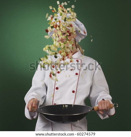 professional cook wok and vegetables - stock photo