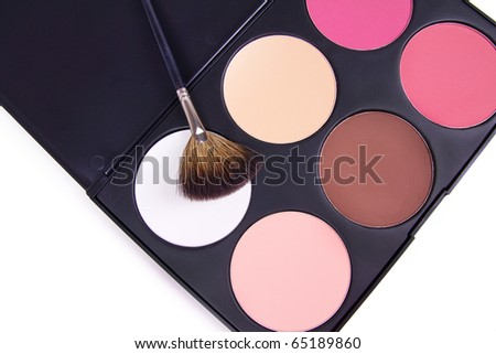 Professional corrector palette with make-up brush, closed-up - stock photo