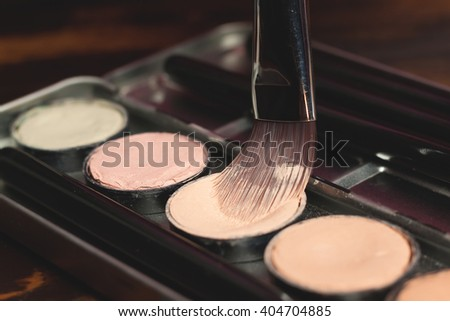 Professional cosmetic. Cream concealer. Working with skin defects.  - stock photo