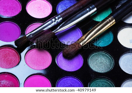 Professional cosmetics. Eyeshadows of different colors - stock photo