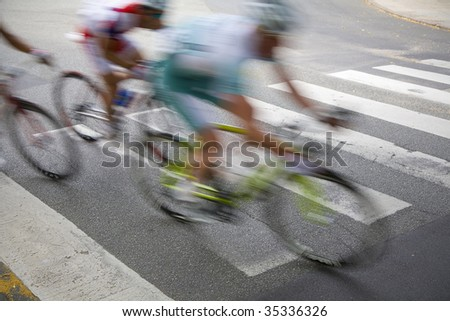 Professional cyclists rushing by just before the finishing line in a great Danish race.