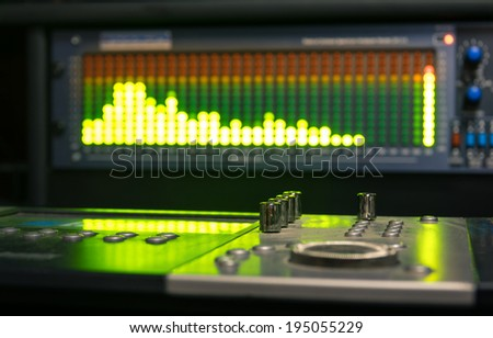 Professional deejay equipment with music mixing controller and sound equalizer - stock photo