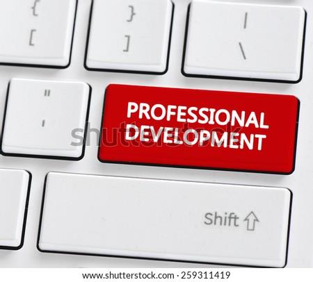 Professional development button. Computer keyboard with professional development button - stock photo