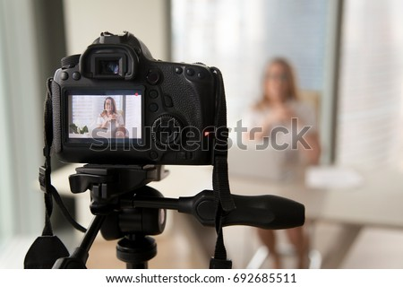 Professional digital equipment recording video blog of businesswoman, online business coach making presentation for website, filming popular vlog or master class for videoblog channel, focus on camera
