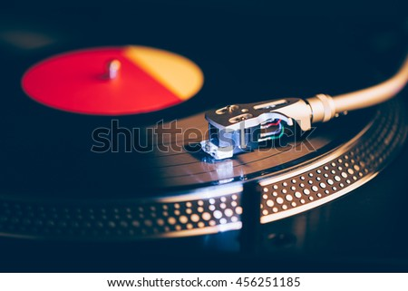 professional dj turntable with illumination, dark background - stock photo