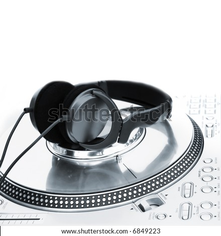 Professional DJ Vinyl Player with green Headphones on it - stock photo