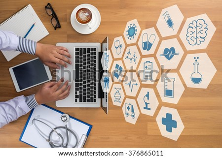 Professional doctor use computer and medical equipment all around, desktop top view,interface as medical concept - stock photo