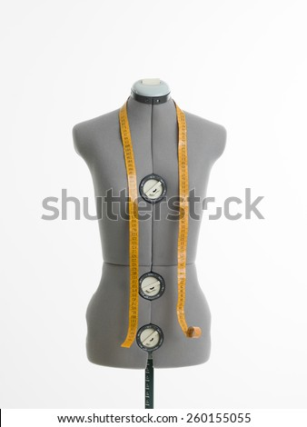 professional dressmakers dummy with measuring tape, on white background - stock photo