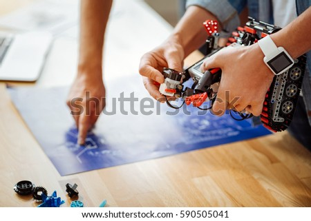 Professional engineers constructing robot