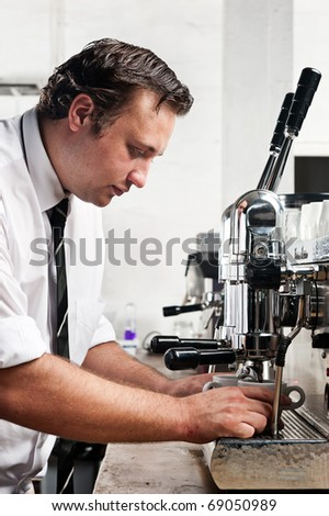 professional expert barista makes coffee with a machine - stock photo