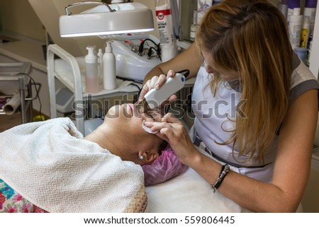 Professional facial treatment for skin. Hardware cosmetology in beauty salon.