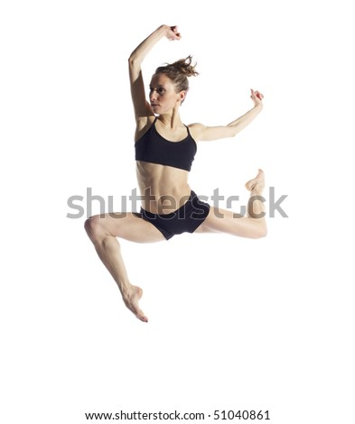 Professional female dancer leaping