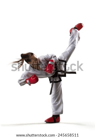 Professional female karate fighter isolated on the white background - stock photo