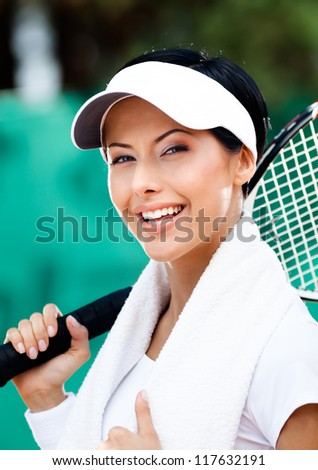 Professional female tennis player with towel on her shoulders. Active pastime - stock photo