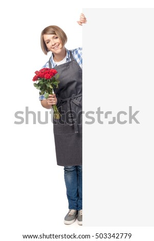 professional florist holding rose flowers and peeking from behind banner with empty copy space isolated on white background. business and floristry concept. advertisement blank board. your text here