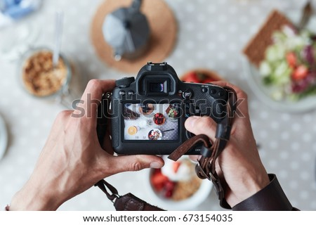 Professional food-photographer making shot of food for advert