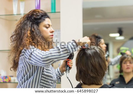 professional girl hairstylist at work with hairdryer hairdresser at hair salon with client - Professional Hairstylist