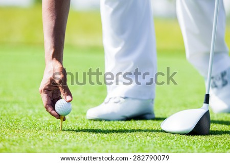 Professional Golf Player teach how to Teed Up Golf Ball