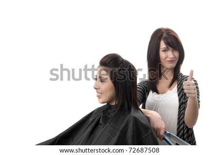 Professional hair stylist with client in chair giving thumbs up - stock photo