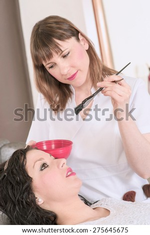professional hairdresser hair dyeing his client - stock photo