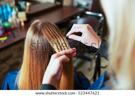 Highlighted hair stock images royalty free images vectors professional hairdresser uses foil pmusecretfo Images