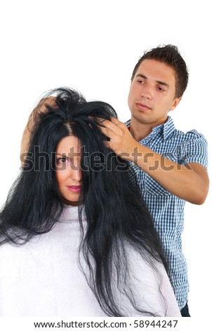 Professional hairdresser  with a customer woman with long hair who looks a bit scared