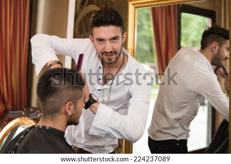 Professional Hairdresser With Short Hair Model - Handsome Young Hairdresser Giving A New Haircut To Male Customer At Parlor - stock photo