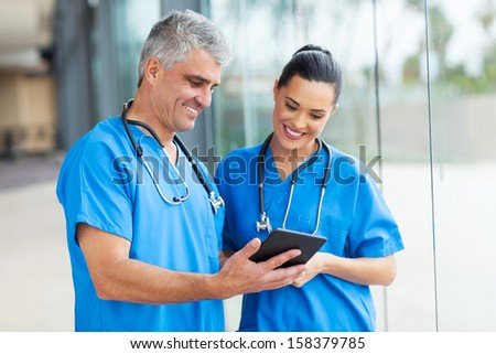 professional healthcare workers using tablet computer - stock photo