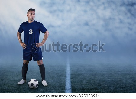 Professional Hispanic Soccer Player on the field ready to play - stock photo