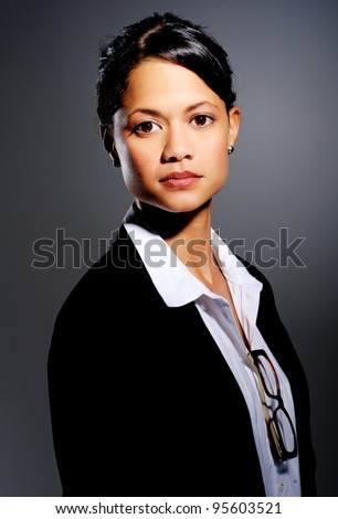 Professional in suit poses for a portrait, with dramatic lighting - stock photo