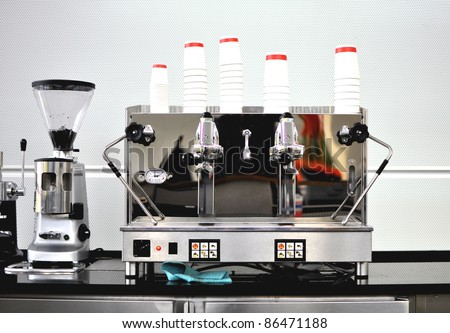 Professional industrial coffee machine in a bar - stock photo