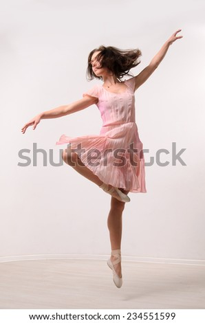 professional jumping ballet female dancer - stock photo