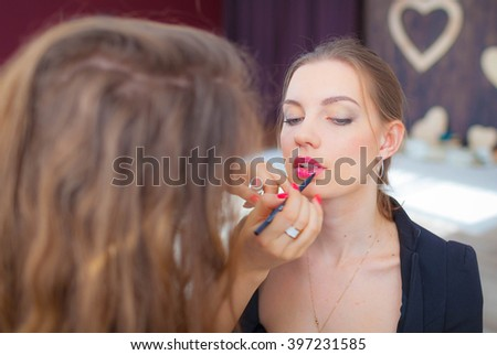 Professional make-up artist doing make-up models. Beautiful make-up. Visagiste.
