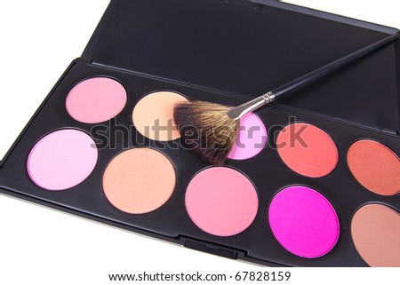 Professional make-up brush and eyeshadows,  closeup