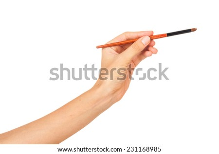 Professional make-up brush cosmetic in female hand beautician isolated on white background
