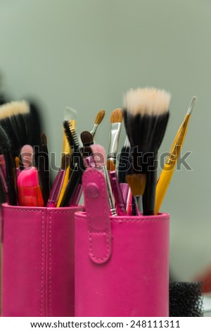Professional make-up brush. Make-up brushes in a special case. Small and large brush wool for applying makeup.Tools for make-up - stock photo