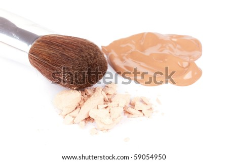 Professional make-up brush near broken eyeshadow and foundation, closed-up - stock photo