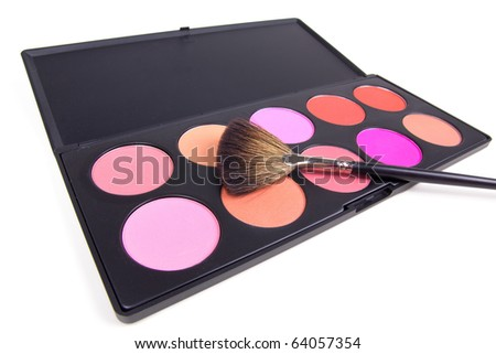 Professional make-up brush on eyeshadows palette, closed-up