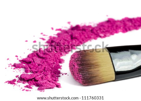 Professional make-up brush on pink crushed eyeshadow - stock photo