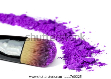 Professional make-up brush on purple crushed eyeshadow - stock photo