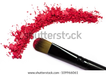 Professional make-up brush on red crushed eyeshadow - stock photo