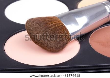 Professional make-up brush on white eyeshadows, closed-up - stock photo