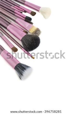 Professional make-up brushes isolated on white background - stock photo