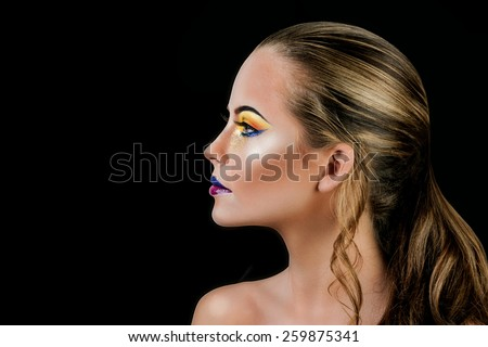 Professional Make up concept. Portrait of young beautiful woman with beauty makeup and perfect skin. Isolated on black background - stock photo