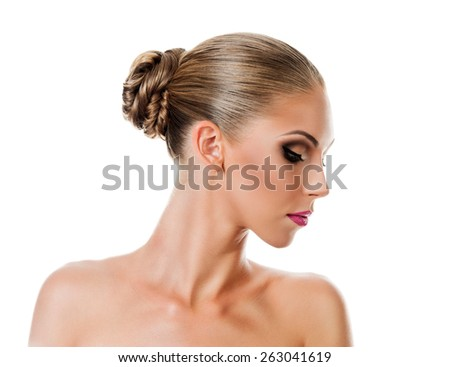 Professional Make up concept. Portrait of young beautiful woman with beauty makeup and perfect skin. Isolated on white background - stock photo