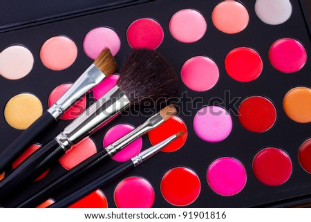 professional make-up multicolor palette with brushes - stock photo
